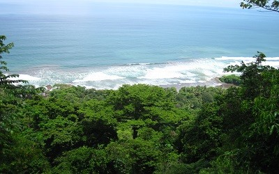 Bird's-eye view of Playa Dominical surf spot. Jazzy's River House vacation rental is walking distance.