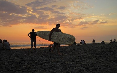 Sunset surfing is just steps from Jazzy's River House Dominical Vacation Rental. Ask about our surfing lessons in Dominical, too.